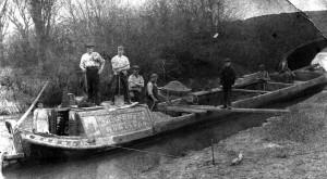 Boatmen on a coal barge