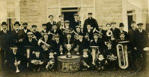 1908 Rev GJ Collis with Evenwood Silver Prize Band, Winners of the Hunwick Cup, in vicarage gardens